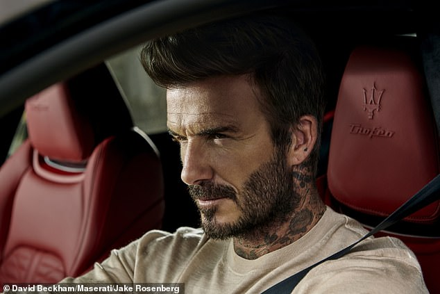 Love it: The soccer star exuded confidence behind the wheel and expertly performed donuts in the red sports car