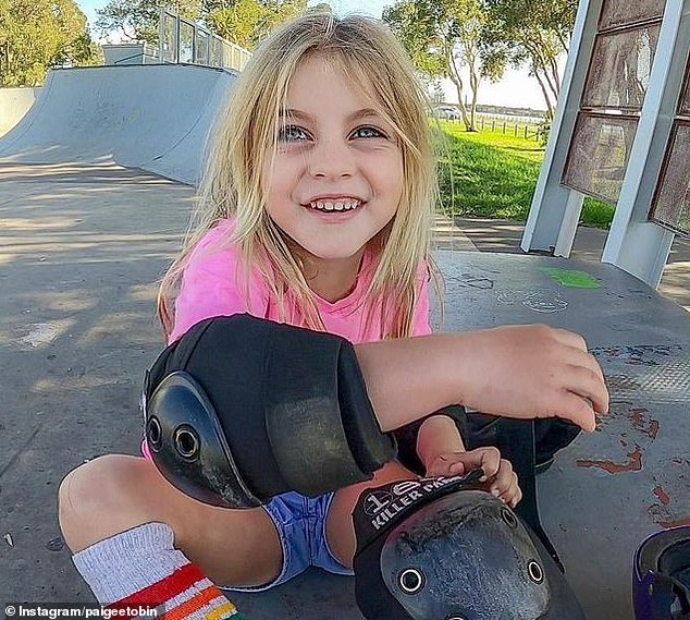 Safety first! Paige makes sure to wear her protective gear when she skateboards