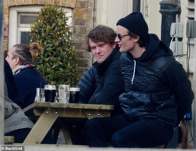 Pals: He was seen enjoying a long-awaited laugh with his companions, who all seemed relieved to be out of the house