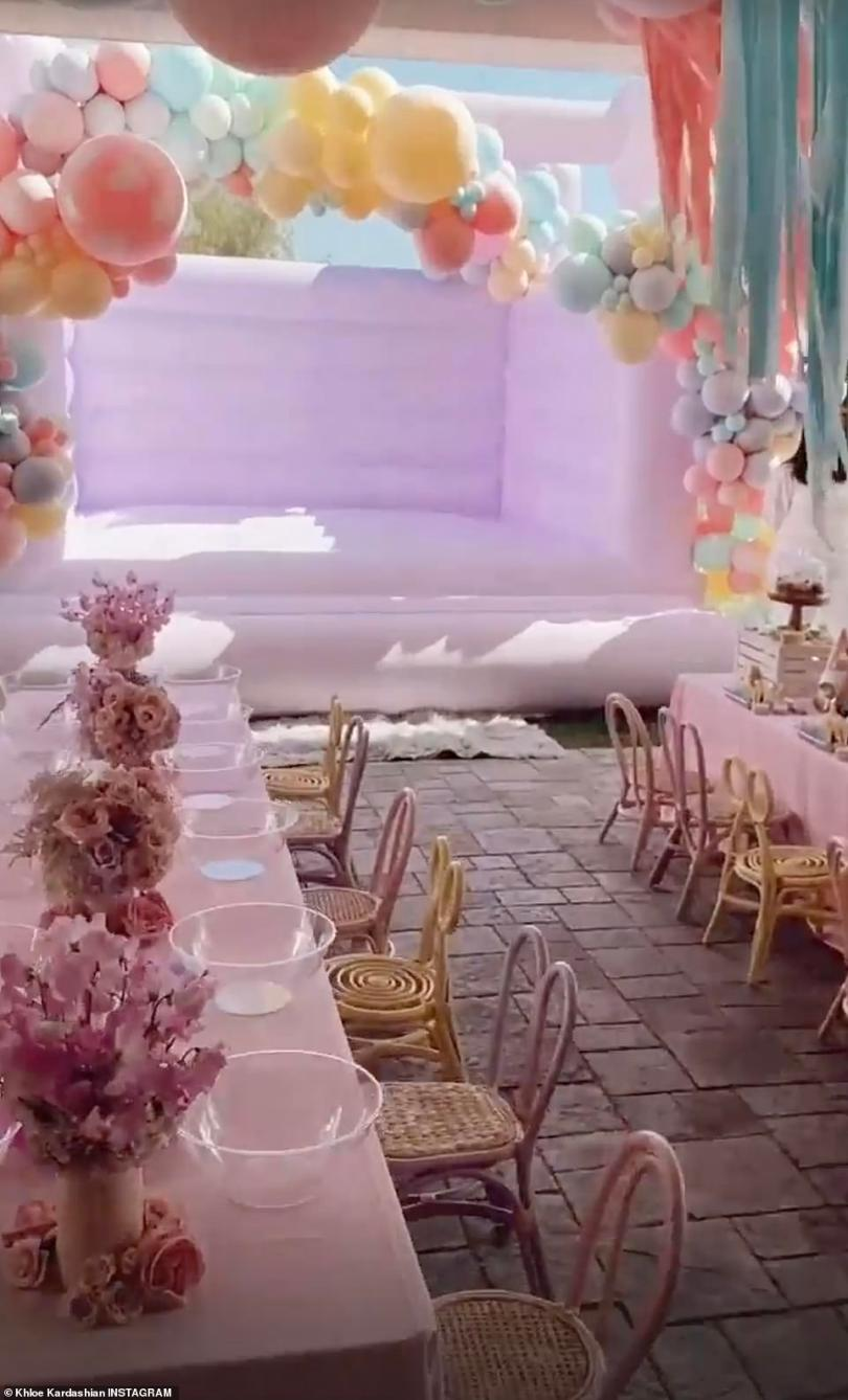 So incredible:Under the covered patio area, there were two long pink tables perfectly decorated with matching followers; one table had empty bowl lining across it while the other was covered in personalized cooking decorating stations for each cousin