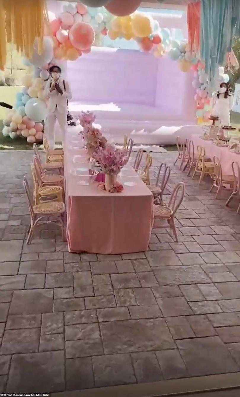 Stunning:Khloe walked straight through the home, passing the hundreds of hand painted balloons to get to the backyard, where an even more elaborate display was waiting for birthday girl True