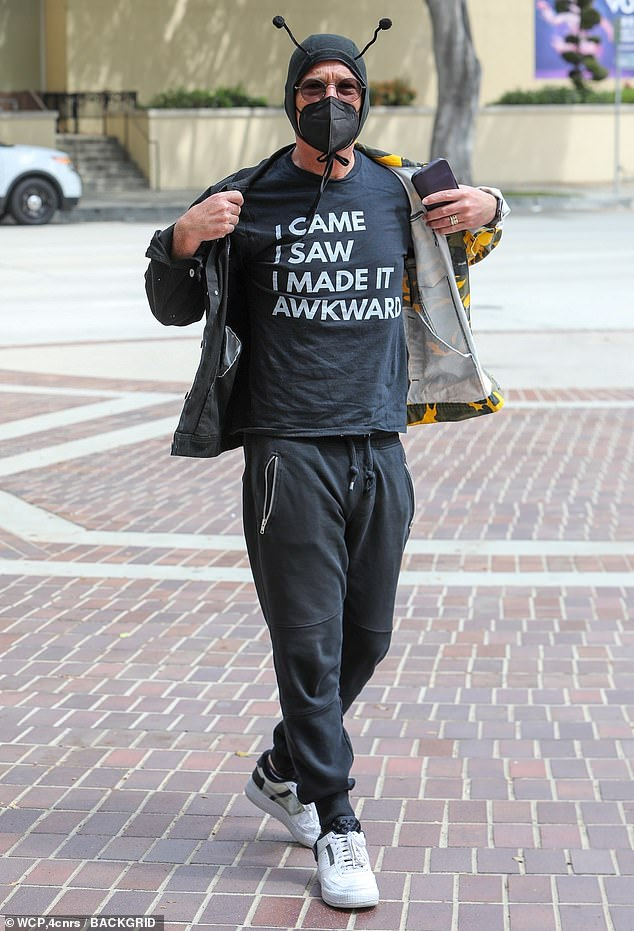 Humorous look: The TV personality rocked a bumble bee headdress and flashed a statement T-shirt that read 'I came I saw I made it awkward,' as he flexed his comedic prowess