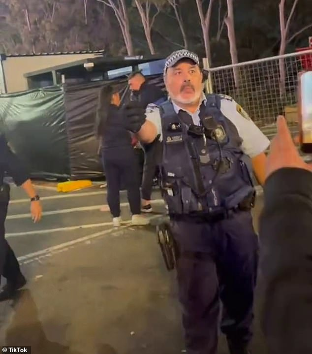A third video taken by another bystander showed a police officer pointing his mace at a group of out of control youths