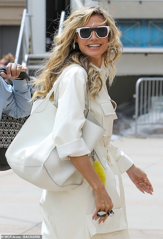 Back at it! The veteran judge leaned into a monochromatic look as she flashed a big grin while walking to set