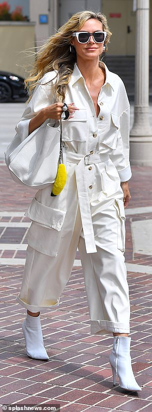 Details: Heidi's look featured mod-style bakelite rings and a humorous banana attached to her white tote bag