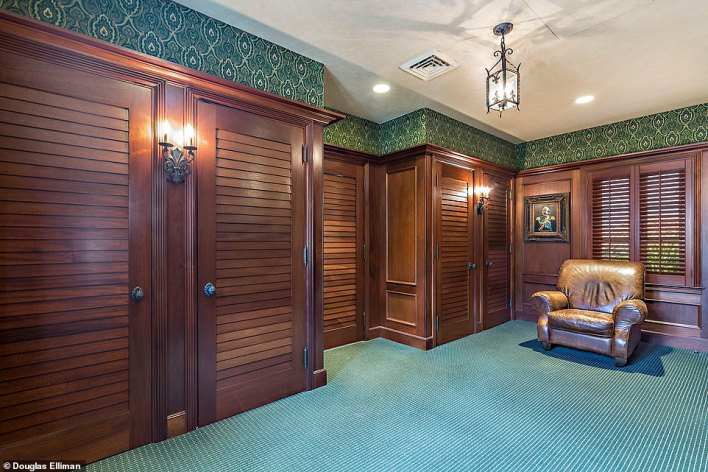 The dressing room looks more like that of a high-end clothing store with mahogany wooden shuttered doors and windows