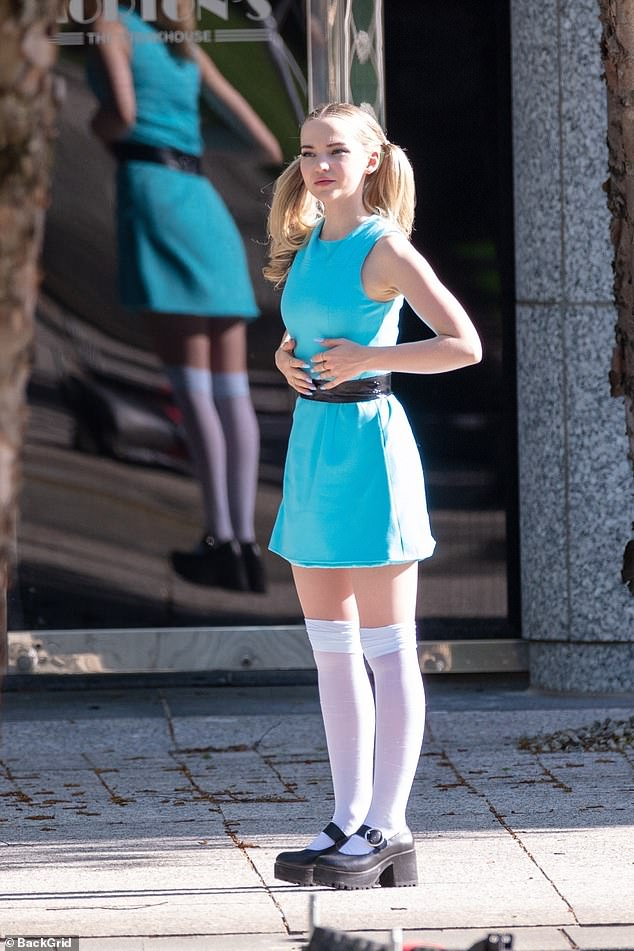Iconic costume: Dovewore a sleeveless blue mini-dress cinched at the waist with a thin black belt along with knee-high white stockings and black platform shoes as she played Bubbles