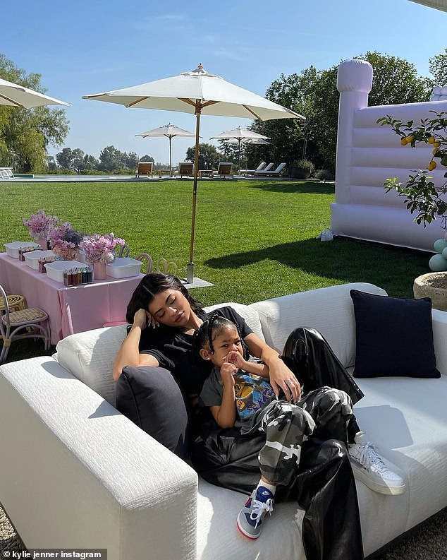 Chilled out: The mommy-daughter duo took a break from the lavish festivities to get some sun on a plush white couch