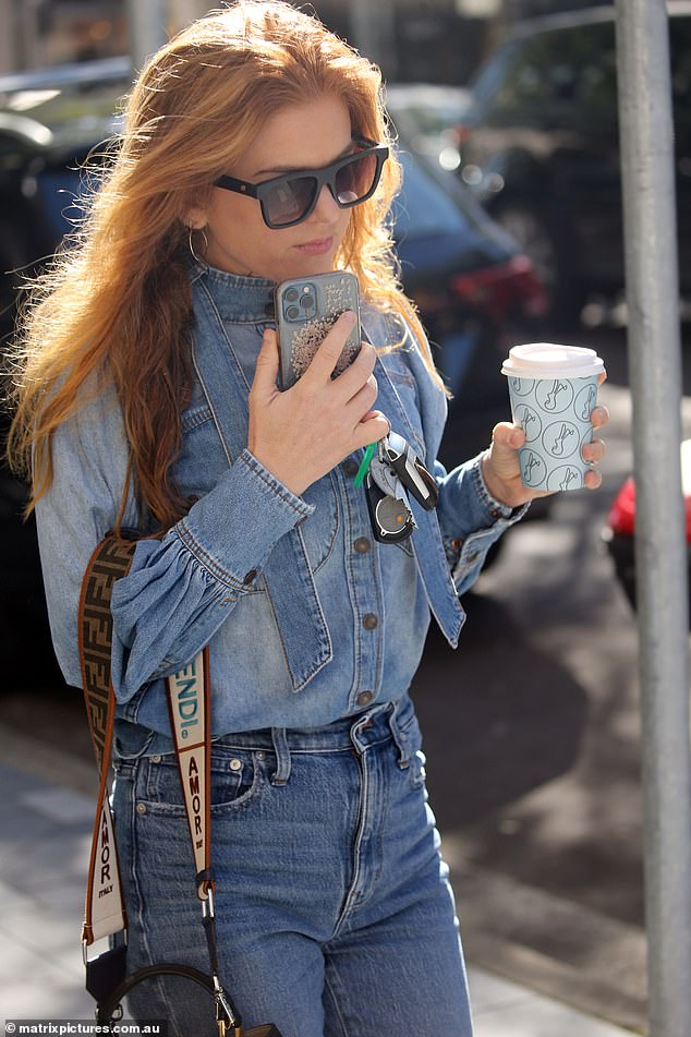 Just jeans:She teamed a button down shirt featuring an undone pussy bow tie and statement puffy sleeves with a pair of high waisted ankle crop jeans, which complemented her petite frame