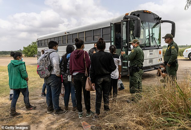 Migrants are ushered onto a CBP bus in La Joya, Texas, on April 11