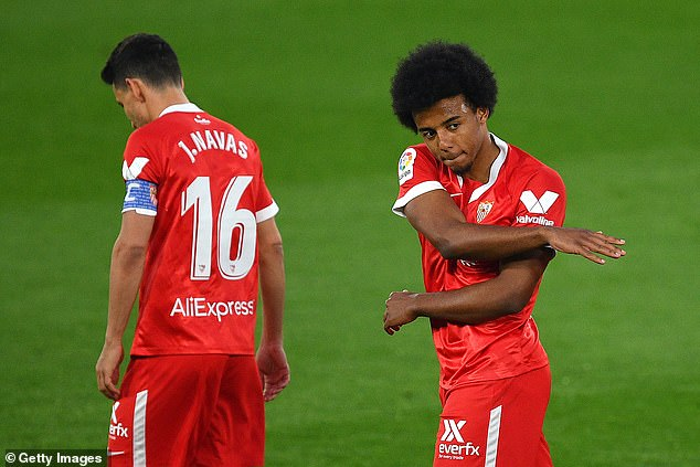 Chelsea are in pole position to sign Sevilla's sought-after defender Jules Kounde (right)