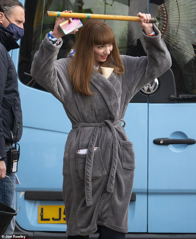 All change: Eleanor later traded her high-visibility vest for a comfortable grey dressing gown