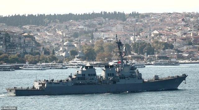 The USSRoosevelt, an Arleigh Burke-class destroyer, is thought to be one of two warships en route to the Black Sea as a deterrent to Russia (file image)