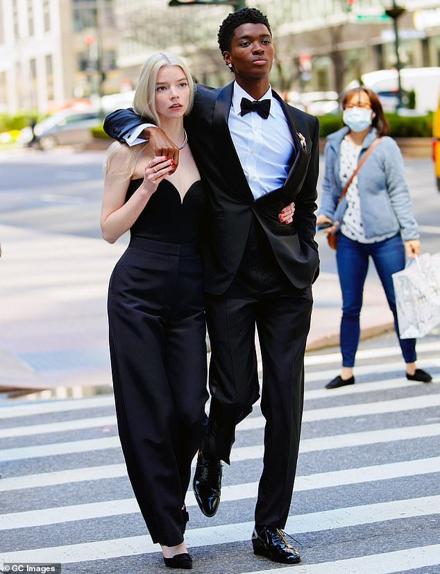 Ready to shoot:Anya Taylor-Joy was busy at work on the streets of midtown New York City on Tuesday morning. But instead of filming The Queen's Gambit or a new film, the actress, 24, was posing for ads for Tiffany & Co alongside a handsome model