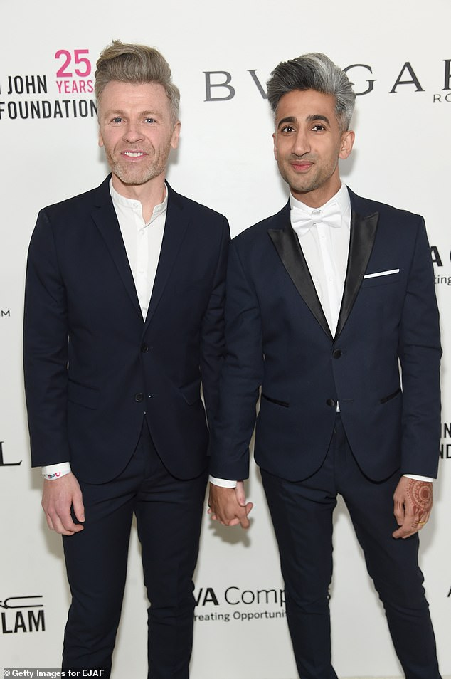 Bliss: He also spoke fondly of his `` happy '' relationship with husband Rob, who he had been married to for 11 years at the time of his appearance on Fresh Air in 2019;  Rob and Tan pictured in 2018