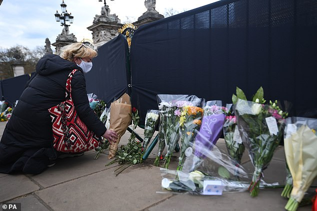 Touching: Tributes poured in from across the country for the Duke, including flowers left at residences such as Windsor and Buckingham Palace [pictured], as the family announced a two-week royal mourning period