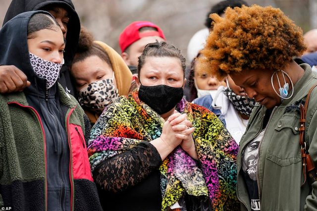 Katie Wright, center, mother of Daunte Wright, arrives to speak during a news conference, Tuesday, April 13, in Minneapolis. Daunte Wright, 20, was shot and killed by police Sunday after a traffic stop in Brooklyn Center