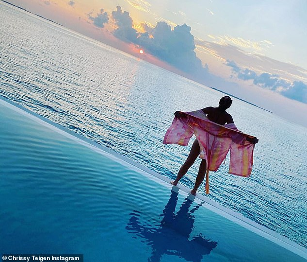 The good life: The catwalk veteran also shared this photo while watching the sunset