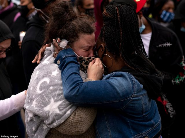 Katie Wright (left), the mother of Daunte Wright, is embraced during a vigil for her son on April 12, 2021 in Brooklyn Center, Minnesota. Wright was shot and killed yesterday by Brooklyn Center police during a traffic stop