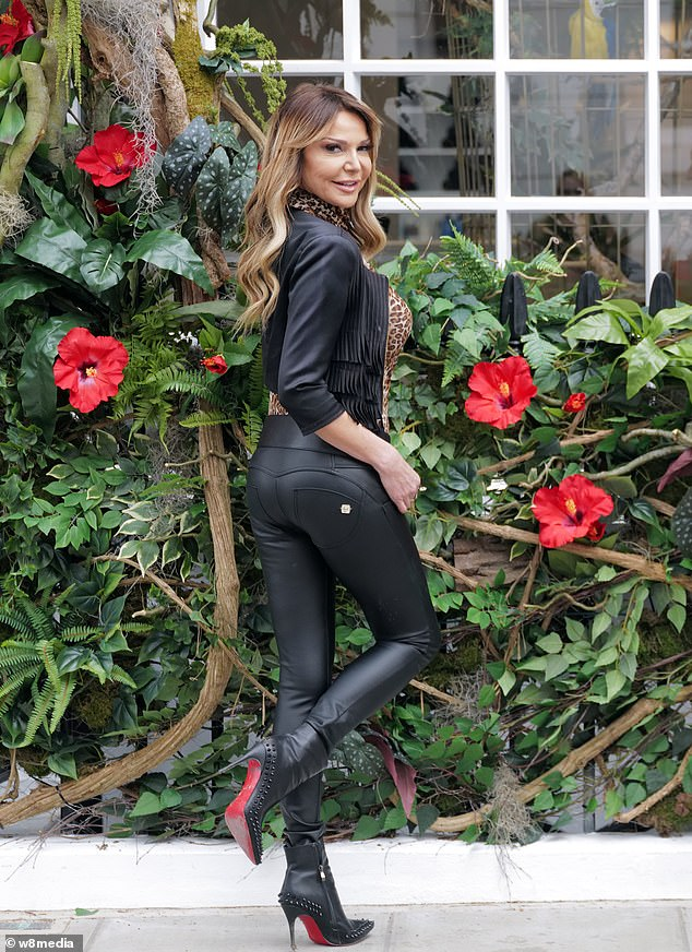 Strike a pose: The TV personality, 52, cut a distinctively glamorous figure for her date, stunning in a leopard-print top and skin-tight leather pants