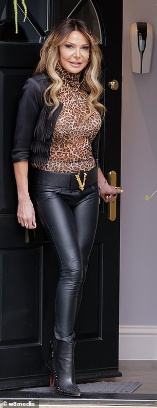 Fashionista: The stunning increased her height with a pair of black pointy heels and added a touch of bling with a gold ring and bracelet