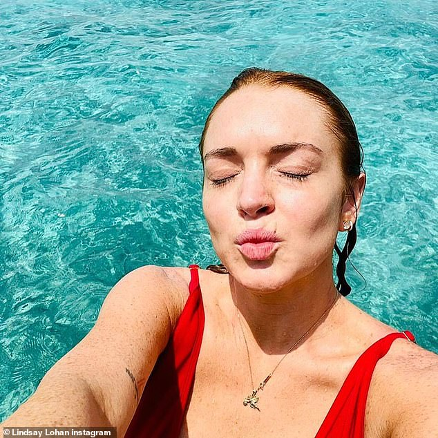 Kiss for my fans!  In another image, the Freaky Friday actress is seen in a close-up without makeup as she looks radiant with her eyes closed and lips puckered up.