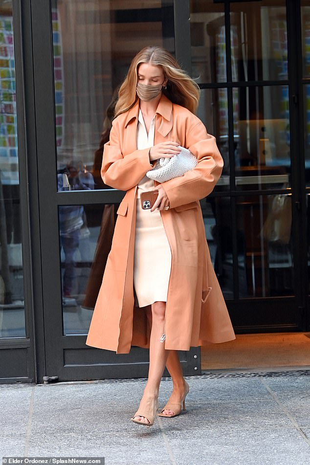 Neutral in spring!  Rosie Huntington-Whiteley showcased her fashion credentials again on Wednesday when she stepped out in a jaw-dropping coral leather coat.