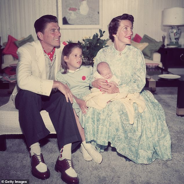 A 1955 family portrait of Ronald Reagan wearing a polka-dot scarf and two tone shoes with his wife Nancy Davis, their daughter Patti Davis and their infant son Ron Jr