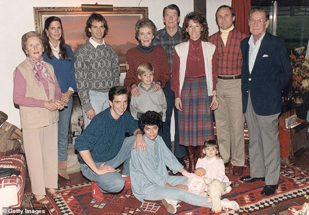 The Reagan family at Rancho del Cielo near Santa Barbara, California, November 28, 1985. Standing (L-R): Bess Reagan, Patti Davis, Paul Grilley, Cameron Reagan, Nancy Reagan, the President, Colleen and Michael Reagan, and Neil Reagan. Foreground, (L-R): Ron, Doria, and Ashley Marie Reagan