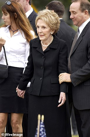 Reagan's relationship with his eldest son Michael (pictured right during his funeral) were the most fraught and led stepmom Nancy to make an extraordinary offer when Reagan neared the end of his life