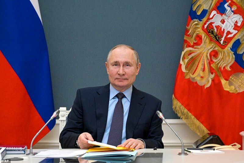 Russian President Vladimir Putin attends a session of the Russian Geographical Society via video link in Moscow, Russia, Wednesday, April 14