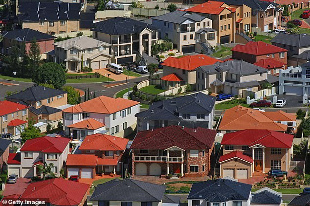 Australian property price growth is expected to slow later this year with city apartments and houses in the far outer suburbs most at risk. Pictured are houses at Cecil Hills in south-west Sydney