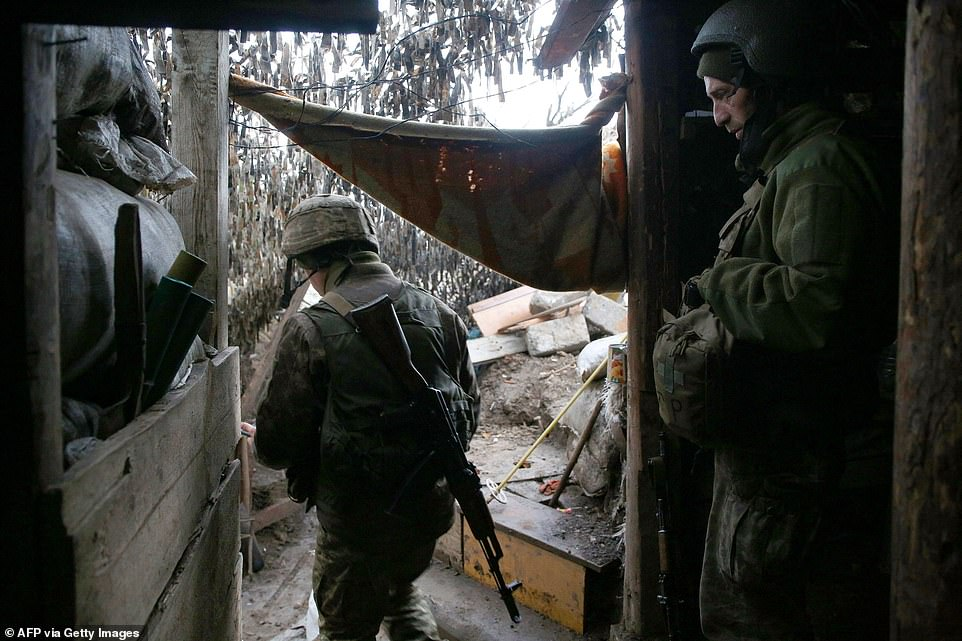 Ukrainian servicemen keep watch at a position on the frontline with Russia-backed separatists near Gorlivka, Donetsk