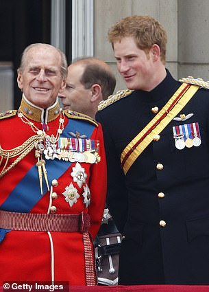 Prince Philip and Prince Harry are pictured in uniform in 2014