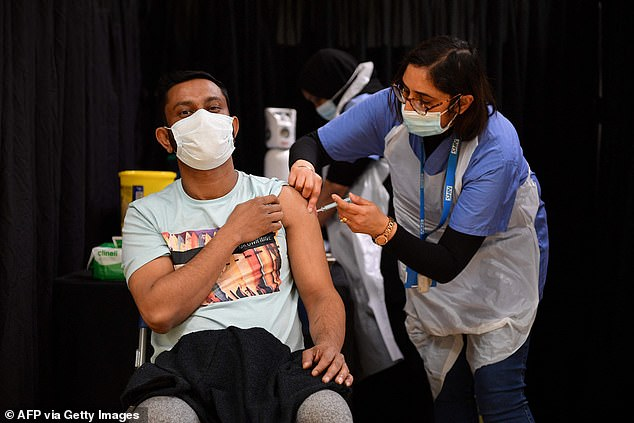 Experts say the risks of not getting vaccinated against Covid are far greater than any risk of having the jab (Pictured: A man being vaccinated in London yesterday, April 14)