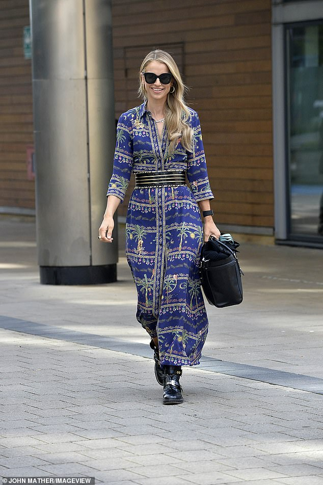Walk this way:Vogue completed her stylish look with black buckled boots and a large black handbag, further accessorising with dark shades, a silver necklace and gold hooped earrings