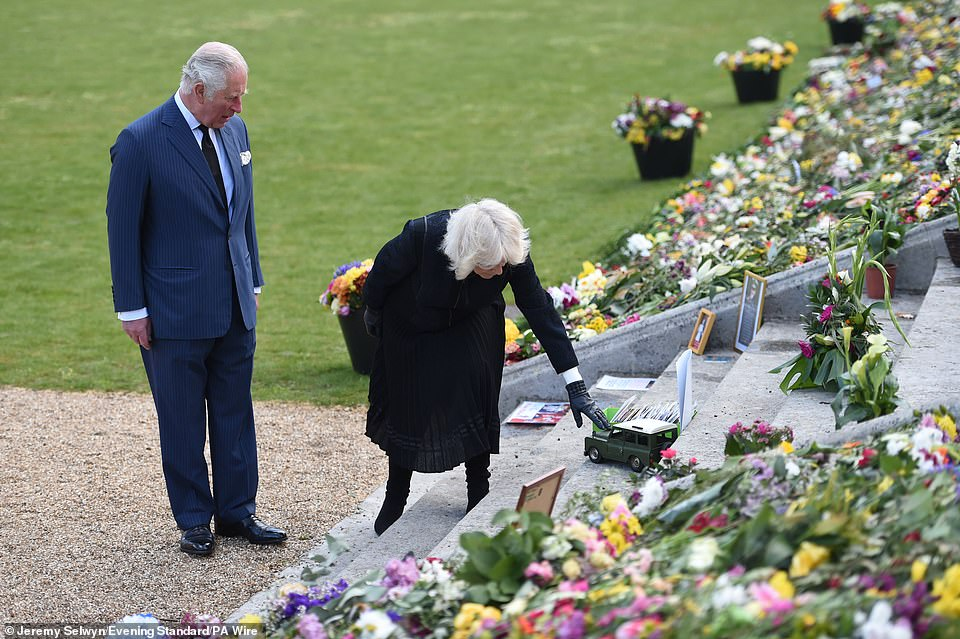 Prince Charles and the Duchess of Cornwall visit the gardens of Marlborough House today to view the flowers and messages