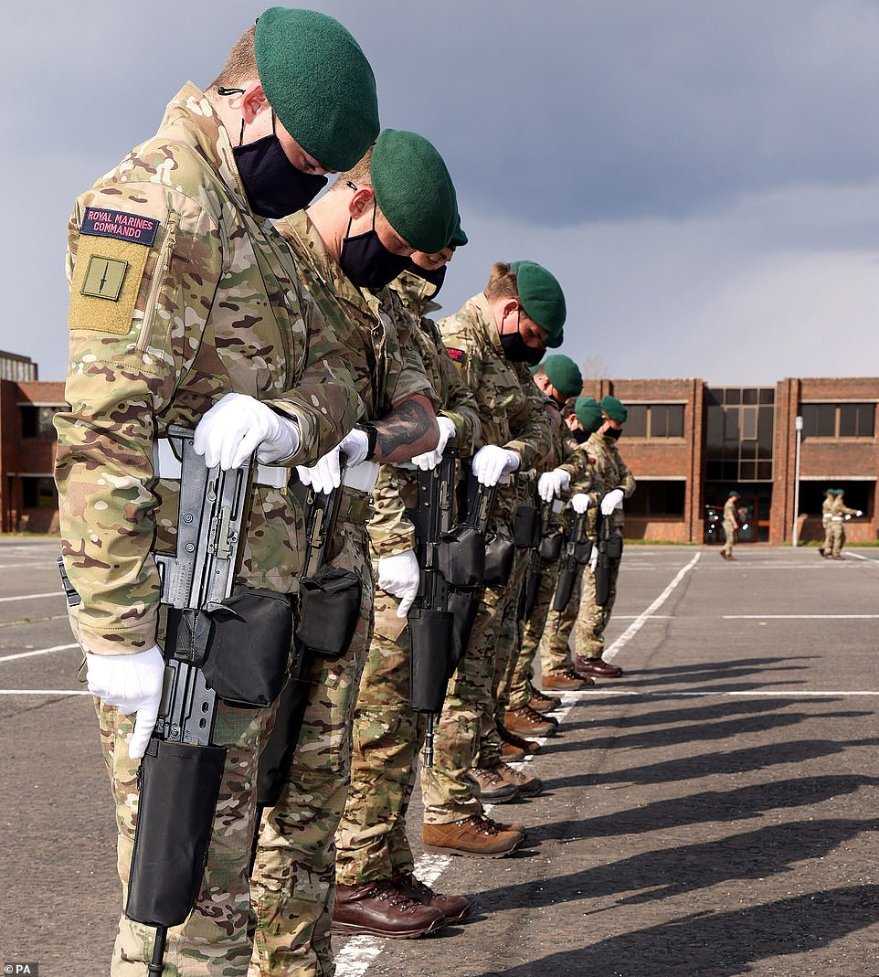 Royal Marines take part in rehearsals for the funeral at HMS Collingwood in Fareham, in an MoD picture released today