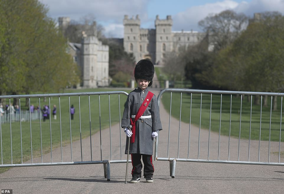 Seven-year-old Max Taylor from Berkshire wears his great grandfather's Grenadier Guards sash on the Long Walk today
