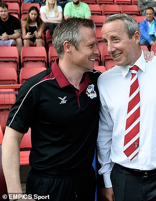 Barmby shares a joke with Lee Bowyer while Scunthorpe coach in 2019