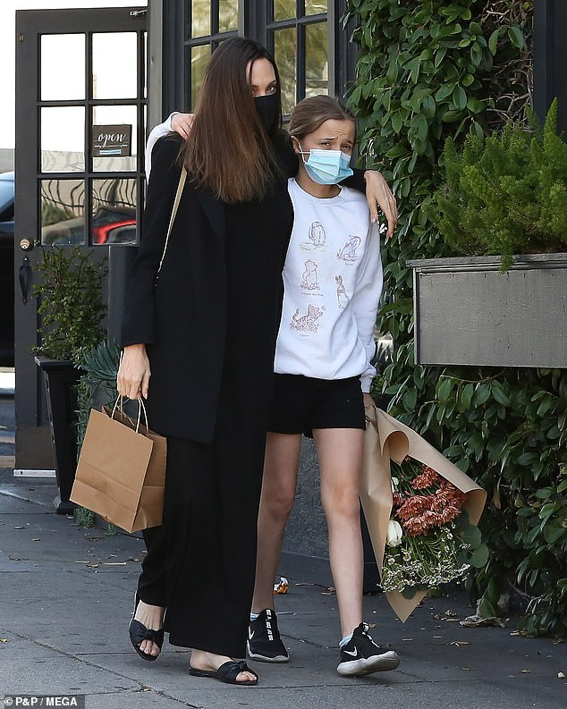 Loving: Angelina Jolie put on a loving display with daughter Vivienne, 12, while out shopping on Thursday afternoon