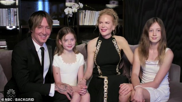 Delighted: The 53-year-old singer performs on two Fearless (Taylor's Version) tracks called We Were Happy and That's When, but suggested that his daughters - Sunday, 12 and Faith, 10 whom he shares with wife Nicole Kidman - were thrilled their dad was in touch with the Bad Blood hitmaker as they are `` big Taylor Swift fans ''