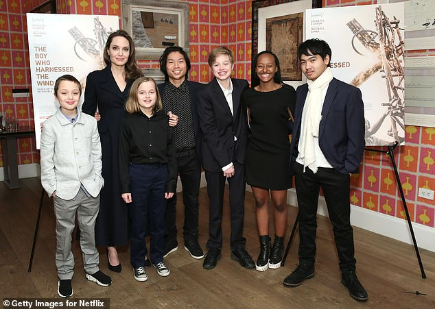 The brood: Angelina shares Vivienne, as well as daughters Zahara, 16, Shiloh, 14, and sons Maddox, 19, Pax, 17, and Knox, 12, with ex husband and fellow actor Brad Pitt; Angelina pictured with (L-R) Knox, Vivienne, Pax, Shiloh, Zahara, and Maddox in 2019