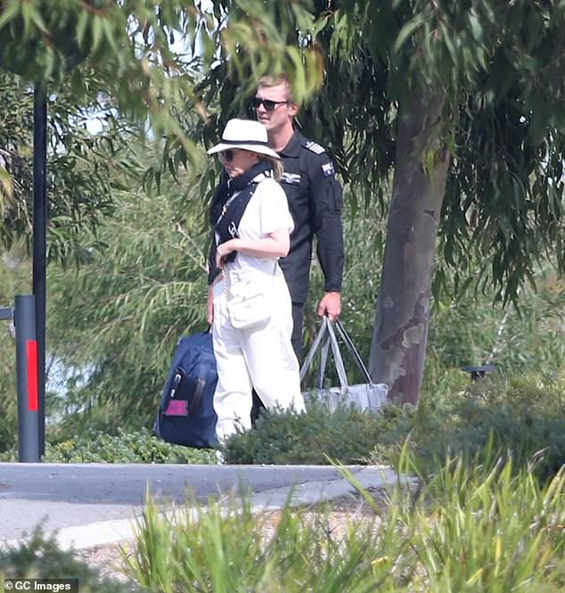 White hot: The Loco-Motion hitmaker looked effortlessly chic in a pair of baggy white pants, which she paired with a crisp white T-shirt