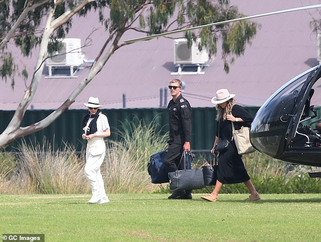 Covered up: Kylie protected herself from the sun with an oversize white fedora with a black band, and black sunglasses