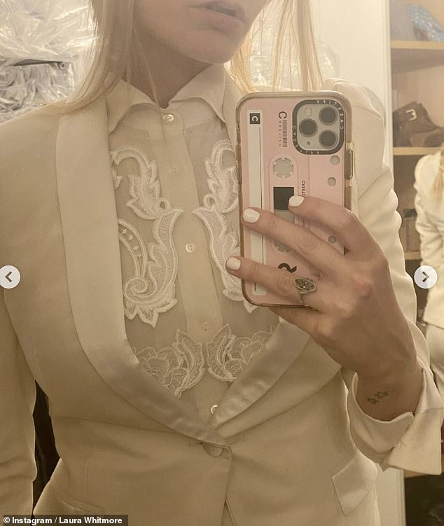 Stunning: The Irish presenter revealed her white suit was made by Joshua Kane bespoke tailoring as she shared several pictures showing the intricate lace and impressive design