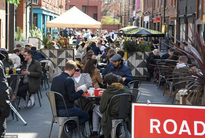 People gather to eat in Manchester this afternon as they enjoy the first Friday of outdoor hospitality being open this year
