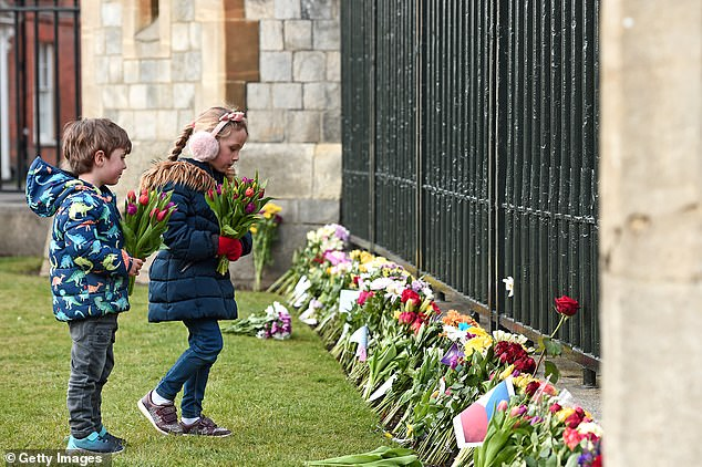 Those who traveled to Windsor Castle to pay tributes today were urged to remove all wrapping from the flowers and warned they would be removed at the end of the day.