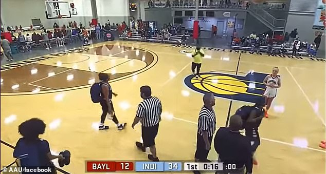 A fight erupted during the Prime Midwest Event at Pacers Athletic Center in Westfield, Indiana, after a referee (pictured with grey hair) called a foul