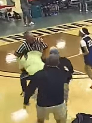 The first spectator picked the referee off the ground